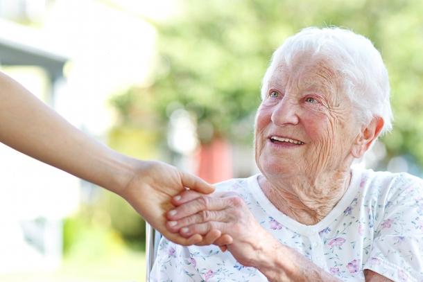 elderlyladyholdinghands